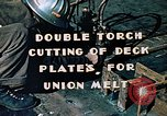 Image of Double torch cutting deck plates for Liberty ship under construction California United States USA, 1942, second 3 stock footage video 65675025804