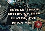 Image of Double torch cutting deck plates for Liberty ship under construction California United States USA, 1942, second 4 stock footage video 65675025804