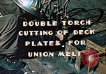 Image of Double torch cutting deck plates for Liberty ship under construction California United States USA, 1942, second 5 stock footage video 65675025804