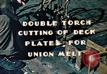 Image of Double torch cutting deck plates for Liberty ship under construction California United States USA, 1942, second 6 stock footage video 65675025804