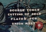 Image of Double torch cutting deck plates for Liberty ship under construction California United States USA, 1942, second 7 stock footage video 65675025804