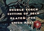 Image of Double torch cutting deck plates for Liberty ship under construction California United States USA, 1942, second 8 stock footage video 65675025804