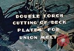 Image of Double torch cutting deck plates for Liberty ship under construction California United States USA, 1942, second 9 stock footage video 65675025804