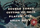Image of Double torch cutting deck plates for Liberty ship under construction California United States USA, 1942, second 10 stock footage video 65675025804