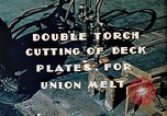 Image of Double torch cutting deck plates for Liberty ship under construction California United States USA, 1942, second 11 stock footage video 65675025804