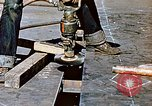 Image of Liberty ship deck plates are prepared for union melt at shipyard California United States USA, 1942, second 10 stock footage video 65675025805