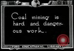 Image of process to get coal chunks United States USA, 1922, second 1 stock footage video 65675025808