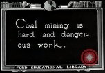 Image of process to get coal chunks United States USA, 1922, second 2 stock footage video 65675025808