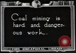 Image of process to get coal chunks United States USA, 1922, second 3 stock footage video 65675025808