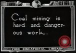 Image of process to get coal chunks United States USA, 1922, second 4 stock footage video 65675025808