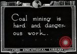 Image of process to get coal chunks United States USA, 1922, second 5 stock footage video 65675025808