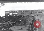 Image of Sightseers look at zeppelin wreckage displayed on dock  Salonica Greece, 1916, second 1 stock footage video 65675025842