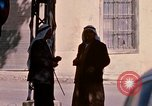 Image of people in the city Baalbek Lebanon, 1968, second 12 stock footage video 65675025903