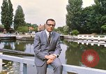 Image of river bank United Kingdom, 1968, second 3 stock footage video 65675025909