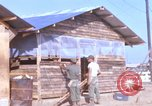 Image of Soldiers building a mess hall Vietnam, 1967, second 1 stock footage video 65675025930