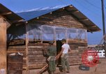 Image of Soldiers building a mess hall Vietnam, 1967, second 3 stock footage video 65675025930