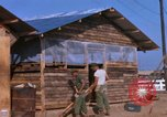 Image of Soldiers building a mess hall Vietnam, 1967, second 4 stock footage video 65675025930