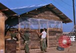 Image of Soldiers building a mess hall Vietnam, 1967, second 11 stock footage video 65675025930