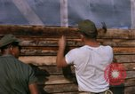 Image of Soldiers building a mess hall Vietnam, 1967, second 12 stock footage video 65675025930