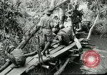 Image of British forces build a bridge across Wami River Tanzania East Africa, 1918, second 2 stock footage video 65675026031