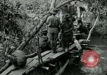 Image of British forces build a bridge across Wami River Tanzania East Africa, 1918, second 4 stock footage video 65675026031