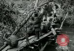 Image of British forces build a bridge across Wami River Tanzania East Africa, 1918, second 5 stock footage video 65675026031