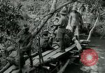 Image of British forces build a bridge across Wami River Tanzania East Africa, 1918, second 7 stock footage video 65675026031