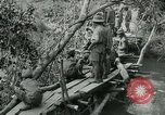 Image of British forces build a bridge across Wami River Tanzania East Africa, 1918, second 11 stock footage video 65675026031
