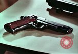 Image of hidden illegal firearms and laboratory at the bureau of  Alcohol and T United States USA, 1961, second 10 stock footage video 65675026150