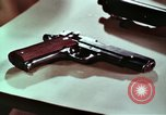 Image of hidden illegal firearms and laboratory at the bureau of  Alcohol and T United States USA, 1961, second 11 stock footage video 65675026150