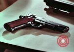 Image of hidden illegal firearms and laboratory at the bureau of  Alcohol and T United States USA, 1961, second 12 stock footage video 65675026150