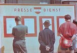 Image of news billboard Austria, 1945, second 2 stock footage video 65675026243