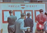 Image of news billboard Austria, 1945, second 3 stock footage video 65675026243
