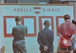 Image of news billboard Austria, 1945, second 4 stock footage video 65675026243