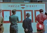Image of news billboard Austria, 1945, second 7 stock footage video 65675026243