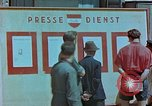 Image of news billboard Austria, 1945, second 8 stock footage video 65675026243