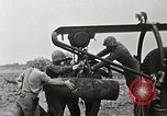 Image of Marines dispose of huge unexploded shell Iwo Jima, 1945, second 9 stock footage video 65675026259