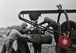 Image of Marines dispose of huge unexploded shell Iwo Jima, 1945, second 10 stock footage video 65675026259