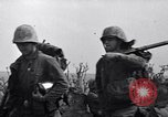 Image of Marines moving along a ridge Iwo Jima, 1945, second 9 stock footage video 65675026281