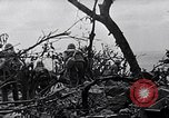 Image of Marines clearing Japanese defenders from a ridge Iwo Jima, 1945, second 10 stock footage video 65675026282