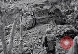 Image of US Marines look for remaining Japanese defenders Iwo Jima, 1945, second 1 stock footage video 65675026283