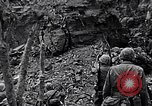 Image of US Marines look for remaining Japanese defenders Iwo Jima, 1945, second 4 stock footage video 65675026283