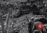 Image of US Marines look for remaining Japanese defenders Iwo Jima, 1945, second 6 stock footage video 65675026283