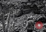 Image of US Marines look for remaining Japanese defenders Iwo Jima, 1945, second 7 stock footage video 65675026283