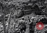 Image of US Marines look for remaining Japanese defenders Iwo Jima, 1945, second 9 stock footage video 65675026283