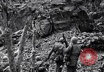 Image of US Marines look for remaining Japanese defenders Iwo Jima, 1945, second 10 stock footage video 65675026283