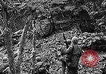 Image of US Marines look for remaining Japanese defenders Iwo Jima, 1945, second 11 stock footage video 65675026283