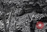 Image of US Marines look for remaining Japanese defenders Iwo Jima, 1945, second 12 stock footage video 65675026283