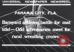Image of dog and goose fight Panama City Florida USA, 1932, second 1 stock footage video 65675026480