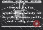 Image of dog and goose fight Panama City Florida USA, 1932, second 2 stock footage video 65675026480